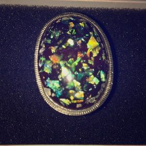 Statement ring with iridescent flecks inside ring
